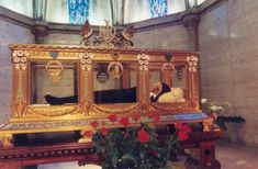The body of St Bernadette Soubirous is displayed in a glass coffin at the Sanctuary of Our Lady of Lourdes, Lourdes, France,. one of the major Catholic pilgrimage sites in the world