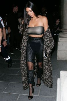 1 Trend, 4 Ways: The Kim Kardashian Paris Fashion Week Story #refinery29  http://www.refinery29.com/2016/09/124964/kim-kardashian-sheer-layering-trend-paris-photos#slide-4  Kardashian piles up different shades of sheer to attend the Off-White show: There's the shadowy-gray bandeau, the paneled trousers, and the translucent black tights....