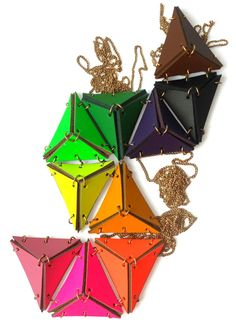 I just got three of these in neon green orange and yellow very cool!  neon leather triangle necklace, leif