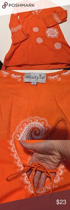 Bright and beautiful beach coverup mud pie, Sz. S, bright orange V-neck beach coverup with embroidered white flowers and tie up neck. Twisted hem at sleeves and bottom, 8in side slits, 32in in length.  Absolutely amazing.  NWOT Mud pie Swim Coverups