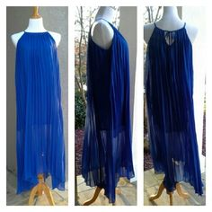 Blue Pleated Maxi Dress Stand out in this lovely alternative to the usual black for the holidays. Blue pleats sway beautifully in moving air. Ties at the neck in back. Lined to the knee. Nice cool 100% polyester. Slightly longer in back than in front. True color is best represented by the 2nd set of photos showing the back of the dress with the tie at the neck. :) Dresses Maxi