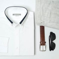 Men's white shirt with navy collar detailing.