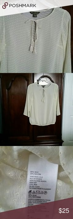 Tommy Bahama see-thru blouse Size XS Very gently loved, only worn twice this beautiful 80%silk  blouse is eggshell  colored with shiny dots.  3/4 sleeve with elasticized waist.  Tie with tassels.   Discount if bundled.   No trades. Tommy Bahama Tops Blouses