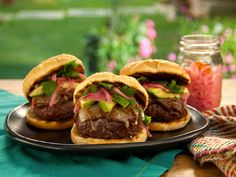 Oaxaca Burger with Manchego, Avocado and Pickled Habanero Onions recipe from Bobby Flay via Food Network