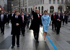 President Donald Trump waves as he walks with