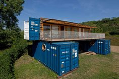artikul architects has constructed a shipping container hotel that comprises a 40 foot-long structure stacked on top of two 20-foot containers.