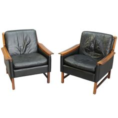 Torbjørn Afdal Black Leather Club Chairs, Pair | From a unique collection of antique and modern club chairs at https://www.1stdibs.com/furniture/seating/club-chairs/