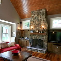 wood floor around fireplace and stained cabinets