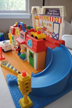 This was the essence of my childhood. =) sooooo many hours playing with this Fisher Price Main Street set.