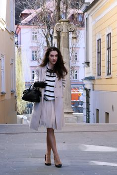 Fashion blogger Veronika Lipar of Brunette From Wall Street sharing how to wear tulle midi skirt this spring