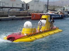 A Yellow Submarine comes into port atPuerto Calero, Lanzarote, Canary Islands.Thistakes tourists on deep submarine cruises to see aquatic wildlife andshipwrecks. From our archive - 2008