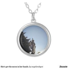 She's got the moon in her hands. silver plated necklace