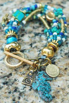 Zakynthos Charm Bracelet: Gorgeous Turquoise, Blue Glass, Gold and Copper Seahorse Charm Bracelet $175