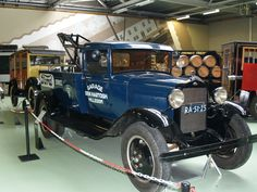 1930 or 1931 Ford Model A tow truck towing another Model A