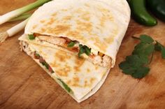 """Hungry Girl's BBQ Chicken Quesadilla: This easy assembly-style dinner from TV host, author and """"foodologist"""" Hungry Girl Lisa Lillien uses high-fiber, low-carb tortillas. Instead of fattening BBQ sauce and sour cream, this recipe substitutes a bit of BBQ sauce with a cheese wedge, which cuts the calories of the original dish in half!"""