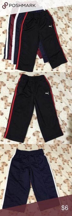 3 pc pants bundle Puma 18 mo red/black pants, Circo 18 mo dark blue/white pants, and Athletic Works 18 mo maroon/white pants. Puma Bottoms Sweatpants & Joggers