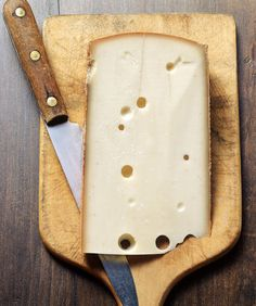 Swiss cheese with knife Fromage Cheese, Charcuterie Cheese, Queso Cheese, Cheese Shop, Cheese Lover, Cheddar, Artisan Cheese, Swiss Cheese, How To Make Cheese