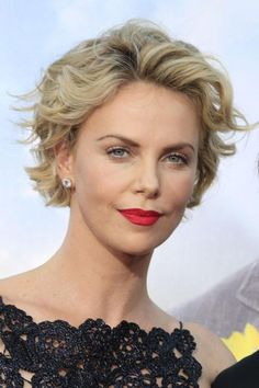 """Charlize Theron's wavy crop is a great example of adding height to a style. Cornwell recommends his clients follow Charlize's lead: """"Try some volume on top, and keep the sides softer to help balance your face shape."""" Spraying your curls back out of your face, as this style does, is one way to minimize width. #CharlizeTheron #RoundFaces"""