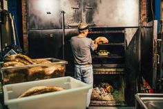 Starr, our owner and pitmaster, loading our smoker! Photo credit: Sam Dean Photography