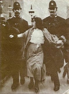 Sixteen-year-old suffragette Dora Thewlis is arrested by two policemen on 20 March 1907