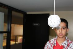Vision Therapy using a Marsden Ball to improve focusing and tracking at Family Eyecare Centre in Victoria, BC, Canada.