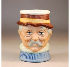 Bisque Egg Cup formed as a Male Character face