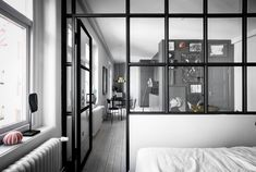 I have been talking about small space living often here, and I love examples like this one, where a small one-room apartment is transformed into a living space with a kitchen, living area and wardrobe. By using a glass partition … Continue reading → Small Space Living, Living Area, Small Spaces, Living Spaces, One Room Apartment, White Apartment, Decoracion Vintage Chic, Interior Windows, White Houses