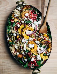 A vibrant yet sturdy pearl couscous and roasted delicata squash salad tossed with tender kale pomegranate arils pepitas and crumbled goat cheese that's perfect as autumnal side dish or a versatile meal prep lunch. Fall Recipes, Whole Food Recipes, Cooking Recipes, Winter Salad Recipes, Couscous Salat, Pearl Couscous Salad, Pearl Couscous Recipes, Roasted Squash, Delicata Squash Recipe