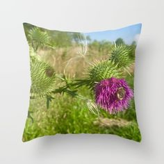 Throw Pillow made from 100% spun polyester poplin fabric, a stylish statement that will liven up any room. Individually cut and sewn by hand, each pillow features a double-sided print and is finished with a concealed zipper for ease of care.  Sold with or without faux down pillow insert. #bee #nature #thistle #pink #green #outdoors #close up