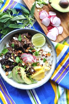 Slow Cooker Carne Adobada Recipe. Classic Mexican beef simmered with peppers and adobo sauce makes the ultimate rice bowl with black beans, radish, avocado, a few slices of pineapple, and some chopped peanuts. #slowcookercarneadobada #carneadobada #adovada #ricebowl
