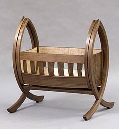 Darling - baby cradle by Dechen J Brooke.  Eastern walnut, quilted maple and lignum vitae - 2011