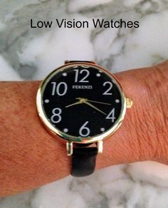 Low Vision Watches use big bold numbers - sometimes a black background with white numbers is easier to read.