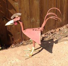 rusty bird yard art