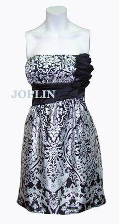 FAJIN: Ceñdor de seda de determinados colores y distintivos que pueden usar generales, jefes y otros funcionarios.