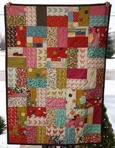 """easy, fast quilt! """"I used a layer cake for the front. I cut each piece in half, sewed 2 together and then cut them to squares."""""""