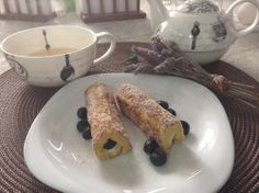 Good Morning French Toast Rollups with cream cheese Filling Vanilla Honey and blue berries !