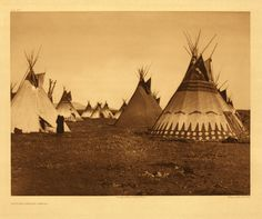 Symbolically painted tipis are frequently observed among the Piegan. Sometimes incidents in the owner's career, especially as a warrior, are depicted, but more often as in this picture, the painting is conventional, and imitative of a tipi seen by the owner in a vision.