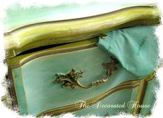 Large French style dresser makeover created by custom mixing paint to match the color of the Tiffany blue bag. Touches of lime green and gold metallic, and antique glaze. #painted furniture, #french dresser