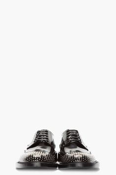 SAINT LAURENT //  BLACK AND SILVER NAIL-PERFORATED BROGUES.