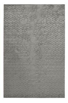 Star silk rug by Helen Amy Murray shown in charcoal, $209 per square foot; therugcompany.com   - ELLEDecor.com