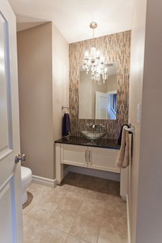 19 Ways to Go Wild with Powder Room Lighting, like putting a chandelier in the space!