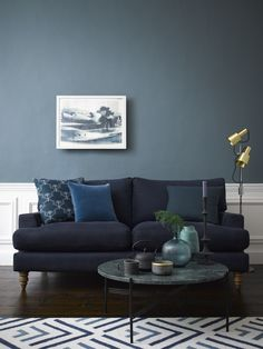 with its delicate mix of blue and grey pigment harmonises perfectly with this midnight blue sofa, while our Estate Emulsion finish, with its chalky matt appearance, adds a sophisticated edge. Living Room Color Schemes, Living Room Colors, Living Room Designs, Blue Couch Living Room, Home Living Room, Living Room Decor Grey And Blue, Farrow Ball, Blue Grey Walls, Blue Lounge