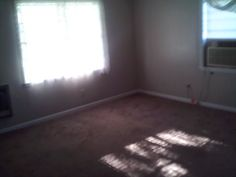front room. was told had new carpet in some of the rooms. lifted up a corner in front bedrm and found black mold. tore up all carpet in house. found molding rotted particle board floors.....