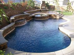 kidney Backyard pool designs with jacuzzi