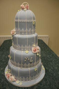 Four tier duck egg blue birdcage wedding cake
