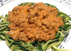 1 pound ground beef  1 clove garlic, minced  1/2 pound mushrooms, coarsely chopped  3 Roma tomatoes, chopped fine  2 tablespoons tomato paste  4 ounces tomato sauce, 1/2 can  1 tablespoon brown mustard or Dijon mustard  Salt and pepper, to taste  1/2 cup sour cream
