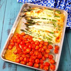 Loading asparagus and cherry tomatoes with mozzarella is ALWAYS a good idea. Get the recipe at Delish.com. #delish #easy #recipe #caprese #asparagus #balsamic #veggies #sides #vegetables #springrecipes #healthyrecipes