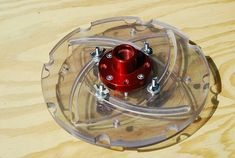 """Longworth chuck - 9 1/2"""" diameter, takes bowls from 3 1/2"""" to 7 1/2"""". Thick plexiglass with a Don Pencil face plate for 1"""" - 8 treads"""