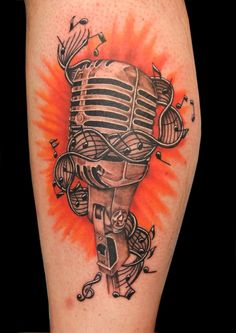 Microphone music tattoo with sheet music...don't like the background color though