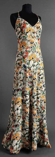 Lucien Lelong evening dress 1935, silk  French couturier who was prominent from the 1920s to the 1940s. Lelong's style, like Chanel's, was influenced by sport and the idea of the body in motion. His word for clothes' capacity to move with the body was kinétique.
